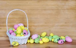 Happy Easter Card with Easter Eggs in Basket Stock Photos