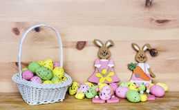 Happy Easter Card with Easter Eggs in Basket and Rabbits Royalty Free Stock Image