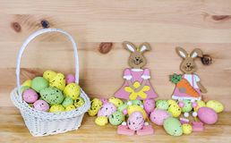 Happy Easter Card with Easter Eggs in Basket and Rabbits Stock Photos