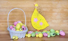 Happy Easter Card with Easter Eggs in Basket and Wooden Chicken Royalty Free Stock Photo