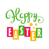 Happy Easter card. Easter hand lettering. Hand calligraphy on a background of flowers. Stock Photos