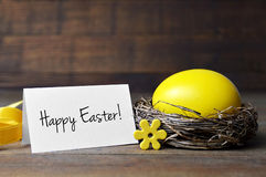 Happy Easter card and egg in the nest Royalty Free Stock Image