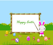 Happy Easter card with eggs and rabbits nearby wood board Royalty Free Stock Photography