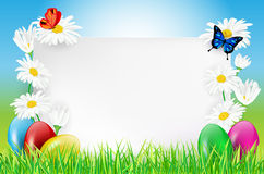 Happy Easter card with flowers and eggs in grass Stock Photography