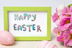 Happy Easter card in a frame with colorful eggs Royalty Free Stock Image