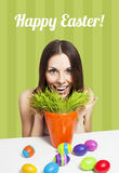 Happy Easter card green. Excited girl and painted eggs on a card Stock Image