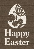 Happy Easter card. Greeting card with egg, butterfly, flower and text Happy Easter on dark brown wooden background royalty free illustration