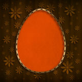 Happy Easter Card - orange egg on brown background Royalty Free Stock Photography