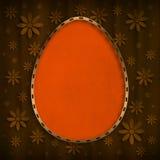Happy Easter Card - orange egg on brown background royalty free illustration