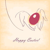Happy easter. Card. red egg in hand. old paper  background Stock Image