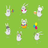 Happy easter card. Set of cartoon rabbits. Easter card with different expressions rabbits. Rabbit Cook, with balloons, cake, wearing top hat, wreath of flowers Stock Photography