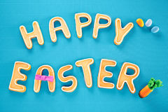 Happy Easter Card On Textured Turquoise Royalty Free Stock Photos