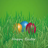 Happy Easter Card - Three Easter Eggs in the Grass Royalty Free Stock Images