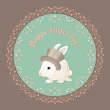 Happy Easter card. White rabbit with hat.  Green background and floral ornament Royalty Free Stock Images