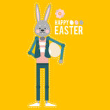 Happy Easter. Cartoon rabbit with egg on yellow background. Card Royalty Free Stock Photos
