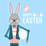 Happy Easter. Cartoon rabbit with egg on yellow background. Card Stock Images