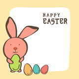 Happy Easter celebration with cute bunny and eggs. Happy Easter celebration greeting card design with cute bunny holding green egg Royalty Free Stock Images