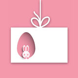 Happy Easter celebration with cute bunny. Cute bunny looking out from paper cutout egg shape for Happy Easter celebration Royalty Free Stock Image