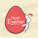 Happy Easter celebration with cute bunny. Cute bunny peeking from big red egg for Happy Easter celebration Royalty Free Stock Photo