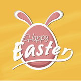 Happy Easter celebration with egg. Easter egg with bunny ears on yellow background Royalty Free Stock Images