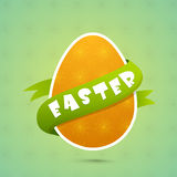Happy Easter celebration with egg. Orange floral decorated egg covered by green ribbon for Happy Easter celebration Stock Image