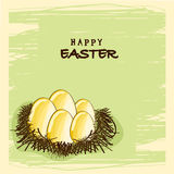 Happy Easter celebration with golden eggs in the nest. Stock Images