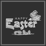 Happy Easter celebration with rabbit and eggs. Stylish text Happy Easter with rabbit and eggs created by white chalk on chalkbord background Stock Photos