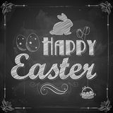 Happy Easter on chalkboard Royalty Free Stock Photography