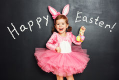 Happy easter! Child with bunny ears and eggs. Stock Photo