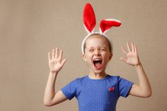 Happy easter. Child girl with bunny ears. Cute little child wearing bunny ears on Easter day Royalty Free Stock Image