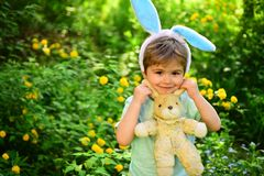 Happy easter. Childhood. Egg hunt on spring holiday. love easter. Family holiday. Little boy child in green forest. Rabbit kid with bunny ears. Hare toy royalty free stock photos