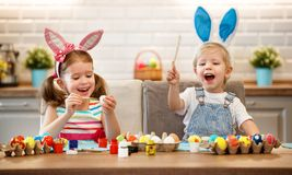 Happy easter! children paints eggs Stock Images