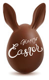 Happy easter. Chocolate Egg with Rabbit Ears Stock Photography