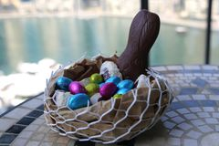 Happy Easter chocolate eggs a basket of sweets bunny Stock Images