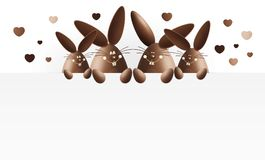 Happy easter, chocolate funny bunnies with heart shape showing t Stock Images