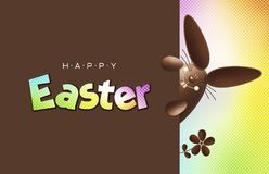 Happy easter, chocolate funny bunny showing the sign with text o Royalty Free Stock Images