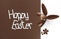 Happy easter, chocolate funny bunny showing the sign with text o Royalty Free Stock Image