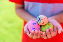 Happy easter! Close up of little kid holding colorful Easter egg royalty free stock photography