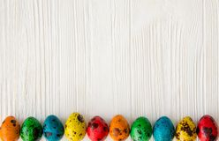 Happy Easter.Colored, boiled, quail eggs. Happy Easter. Colored, boiled, quail eggs on a white wooden background royalty free stock photography