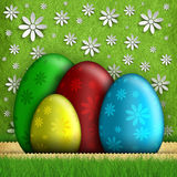 Happy Easter - colored eggs on green background vector illustration