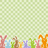 Happy Easter - colorful bunnies on checkered pattern Stock Photography