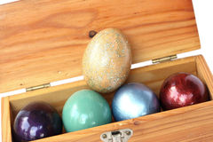 Happy easter. Colorful easter eggs in wood box on white backgrou Royalty Free Stock Image