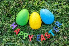 Happy Easter with Colorful Eggs cute bunny in the morning, Funny decoration in grass spring season stock image