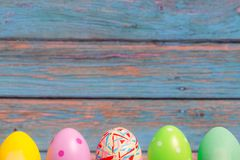 Happy easter, colorful easter eggs standing with blue wooden backgrounds, easter holiday decorations concept with copy space royalty free stock photos