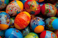 Happy Easter. Colorful painted eggs decorated with colored foil with inscription happy Easter Royalty Free Stock Image