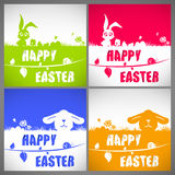 Happy easter colorful vector illustration cards Set with the big-eared rabbits and chicken silhouettes on the meadow Stock Photos