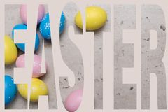 Happy Easter concept background.Easter eggs on table royalty free stock image