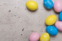 Happy Easter concept background. Easter eggs on table royalty free stock photos