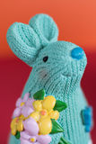 Happy Easter concept, blue easter bunny with flowers. On red background, postcard Royalty Free Stock Photography