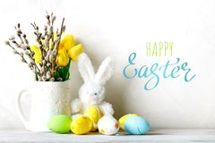 Happy Easter. Congratulatory easter background. Easter eggs and rabbit. Happy Easter. Congratulatory easter background. Background with copy space. Selective royalty free stock photos